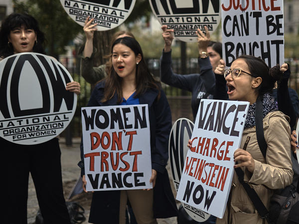 A group gathered outside the Manhattan District Attorney's office on Oct. 13 protests the DA's decision not to prosecute Harvey Weinstein in connection with a 2015 incident involving a model.