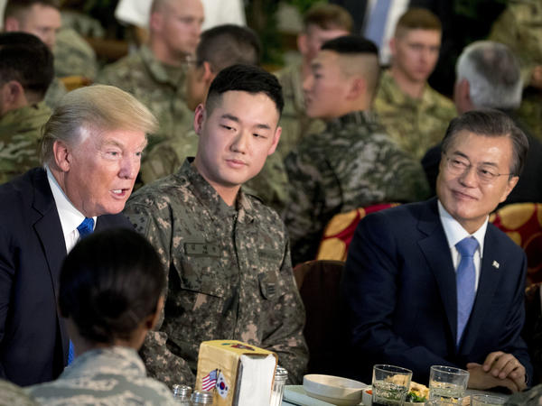 President Trump and South Korean President Moon Jae-in, right, have lunch with U.S. and South Korean troops at Camp Humphreys in Pyeongtaek, South Korea, on Tuesday.