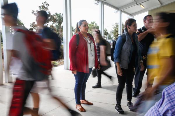 Yara Ramos oversees dismissal at SunRidge Middle School.