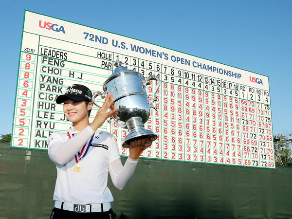 Park Sung-hyun poses with the trophy after the final round of the U.S. Women's Open golf tournament on July 16 at Trump National Golf Club in Bedminster, N.J. Park was among a number of South Korean golfers who were top finishers.