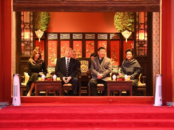 Chinese President Xi Jinping and his wife, Peng Liyuan, hosted President Trump and first lady Melania Trump during a tour of the Forbidden City in Beijing on Wednesday at the start of the third leg of Trump's Asian tour.