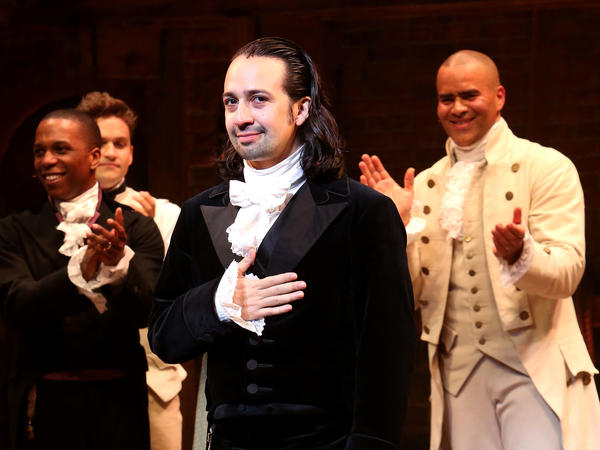 Lin-Manuel Miranda (center) performs in <em>Hamilton</em> in July 2016 in New York City.