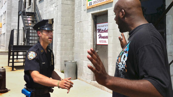 Det. Anthony Mannuzza (left) and police officer Robert Martin of the New York Police Department simulate a street stop during a training session.