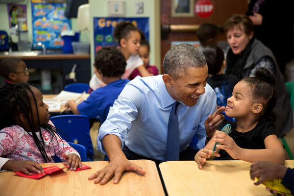 """While we were in Lawrence, Kan., we stopped at the Community Children's Center–one of the nation's oldest Head Start providers. The president sat next to Akira Cooper, right, and reacted to something she said to him."" (Official White House Photo by Pete Souza)"