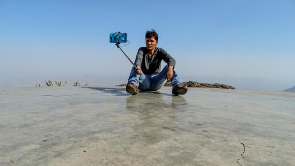 A man snaps a selfie in Bharuch, India.