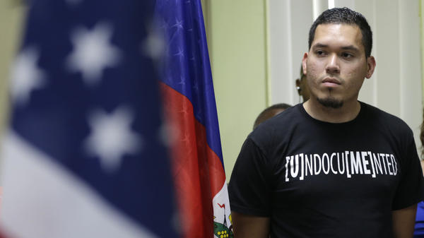Julio Calderon, 28, an undocumented immigrant from Honduras, listens after speaking in favor of renewing temporary protected status for immigrants from Central America and Haiti now living in the United States, during a news conference Monday, Nov. 6, 2017, in Miami.