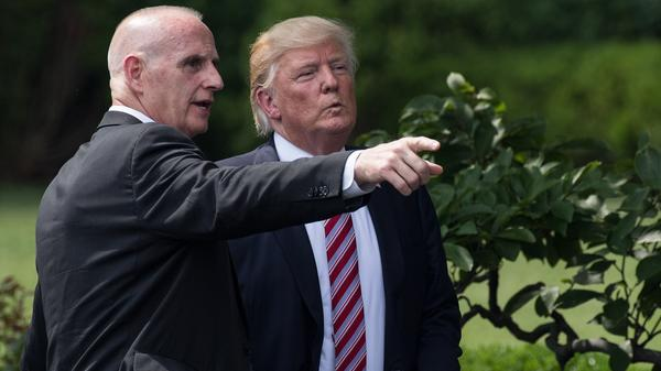 President Trump listens to then-Director of Oval Office Operations Keith Schiller at the White House on June 12.