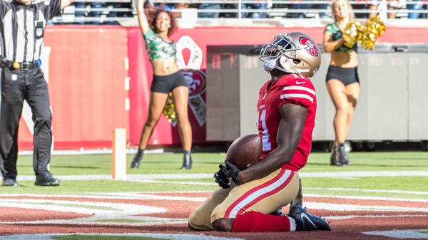 San Francisco 49ers wide receiver Marquise Goodwin fell to his knees in the end zone after scoring a touchdown against the New York Giants on Sunday. He later revealed that he and his wife had endured a personal tragedy.
