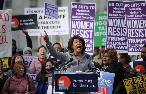 Rep. Maxine Waters, D-Calif., addresses a rally against the Republican tax plan outside the U.S. Capitol on Nov. 1. An analysis of the House and Senate proposals show they are likely to benefit the wealthy more than lower-income Americans.