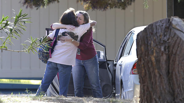Two women embrace outside Rancho Tehama Elementary School, in Corning, Calif., where a gunman opened fire Tuesday.