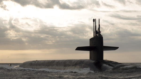 The ballistic missile submarine USS Rhode Island returns to port after a patrol. The president of the United States has the unilateral authority to order it to launch its nuclear weapons.