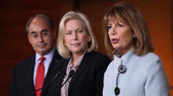 Rep. Jackie Speier, D-Calif. (right), Sen. Kirsten Gillibrand, D-N.Y., and Rep. Bruce Poliquin, R-Maine, speak at a press conference on sexual harassment in Congress on Wednesday in Washington, D.C.