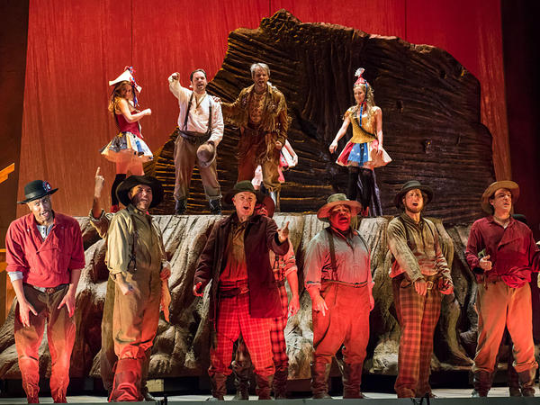 Miners on stage for a rehearsal of <em>Girls of the Golden West</em>, the new opera by John Adams and Peter Sellars, which premiered at the San Francisco Opera Nov. 21.