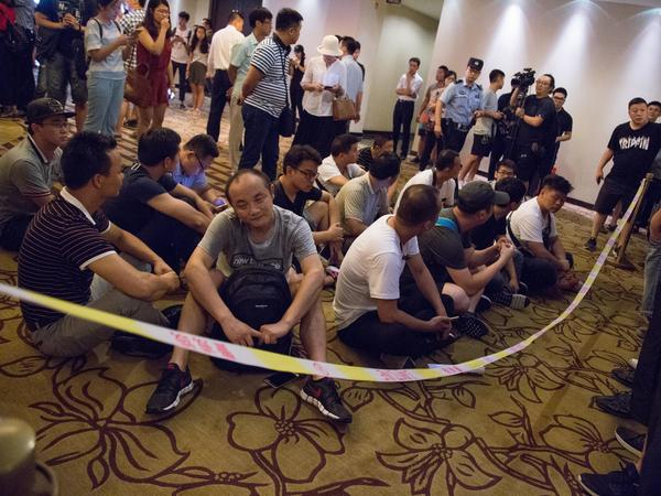 Debt collectors gather at Beijing's Radegast Hotel, where LeTV, a LeEco subsidiary, held its interim shareholders general meeting on July 17.