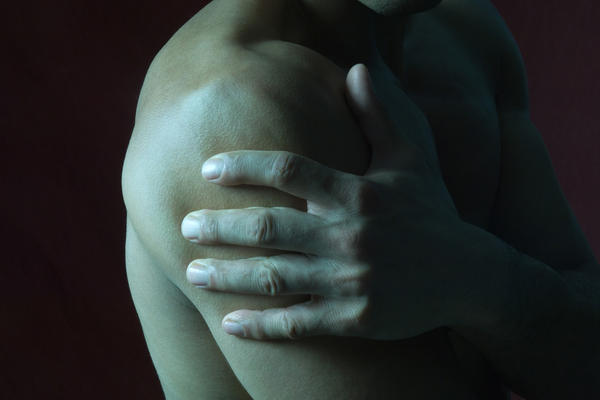 "Doctors think the chronic pain of ""shoulder impingement"" may arise from age-related tendon and muscle degeneration, or from a bone spur that can rub against a tendon."