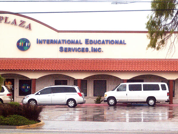 "The International Educational Services, Inc. is shown Thursday, July 19, 2007, in Brownsville Texas, as a van drops off children at the entrance. The service takes care and placement of illegal immigrant children in foster homes where they live until they can be united with a ""sponsor,"" a parent, relative or family friend within the United States."