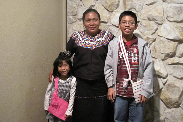 Maria Luis (center) with her children Angie and Daniel on the day they were reunited in 2011. The children spent five years in the foster system after federal immigration officials sent Luis back to her native Guatemala.