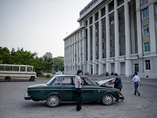 In September 2013, a man takes a look under the hood of a Volvo 144 in Pyongyang.