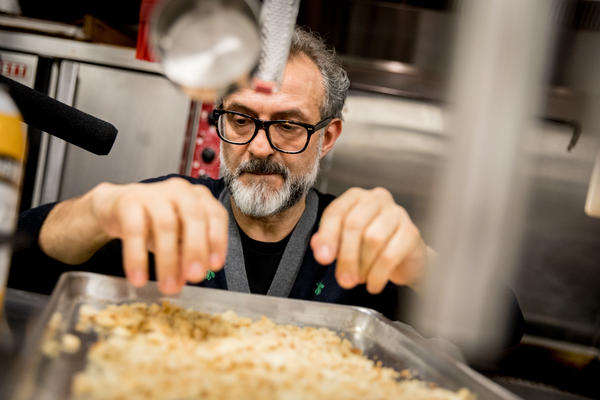 "Chef Massimo Bottura creates a meal from Thanksgiving leftovers in NPR's kitchen. ""The leftover is a big problem if you don't have a vision, if you don't have the knowledge of what you can do,"" he says. Above, he checks the breadcrumbs to make sure they're dry and fine enough to turn into a pasta called passatelli."