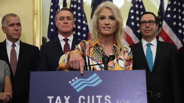 White House counselor Kellyanne Conway speaks at a press conference with (from left) Republican Sens. Thom Tillis and David Perdue, and Treasury Secretary Steve Mnuchin on Nov. 7. Only 2 percent of economists polled thought the GOP tax plan would lead to higher growth.