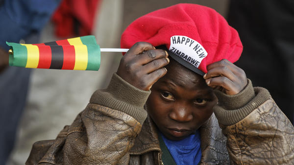 A young supporter of Mnangagwa adjusts his beret as he awaits his arrival at the ZANU-PF party headquarters in Harare, Zimbabwe on Wednesday.