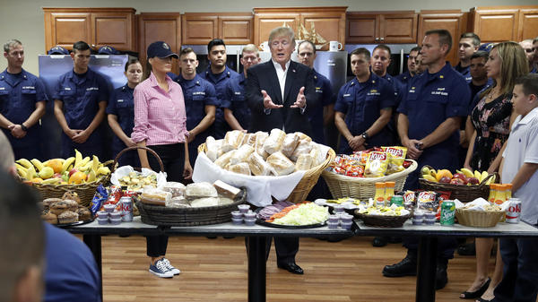 President Donald Trump, with first lady Melania Trump, speaks to members of the U.S. Coast Guard at the Lake Worth Inlet Station on Thanksgiving. The president also spoke to U.S. service members abroad, via a video call from his private Florida club.