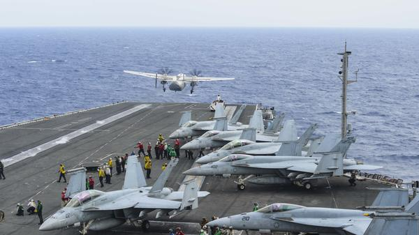 A C-2A Greyhound launches from the flight deck of the aircraft carrier USS Ronald Reagan on Nov. 17. Five days later a C-2A crashed into the Philippine Sea. Three sailors were lost at sea.