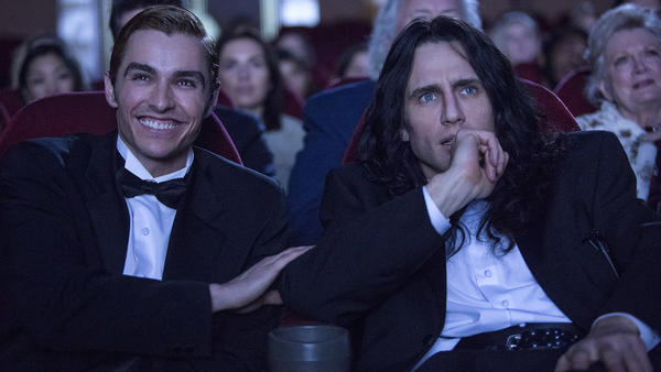 Nothing's Gonna Tear Them Apart, Lisa: Greg (Dave Franco) and Tommy (James Franco) wait for the lights to go down in <em>The Disaster Artist</em>.
