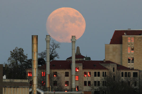 The moon rises beyond the University of Kansas campus in Lawrence, Kan., Nov. 13, 2016. The 2017 supermoon will appear Dec. 3.