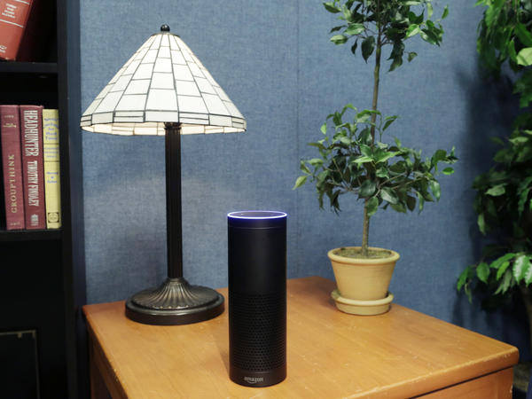 An Amazon Echo, circa 2015, perched on a table beside a lamp. Not pictured: the actual Amazon Echo referenced in the case against James Bates.