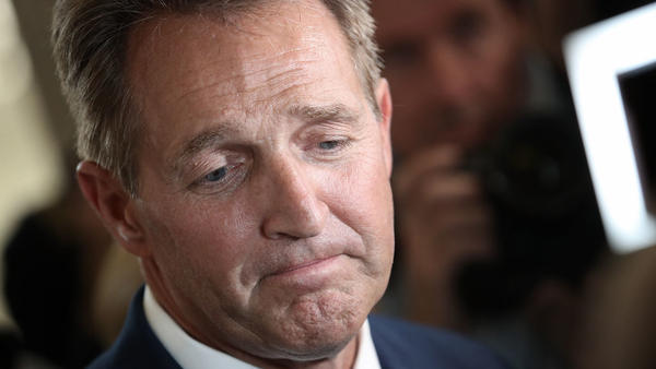 Sen. Jeff Flake, R-Ariz., speaks to reporters after announcing he will not seek re-election in October.