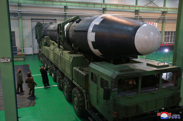 North Korean leader Kim Jong Un views the Hwasong-15 missile in this undated photo released by North Korea's Korean Central News Agency.