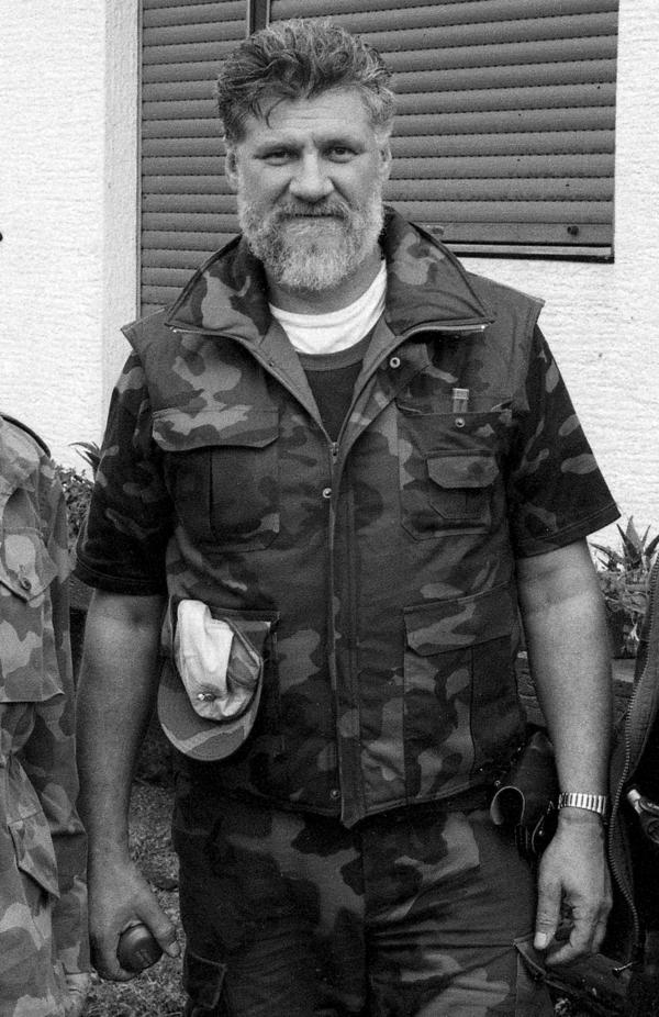 In a photo taken in 1991, Slobodan Praljak poses holding a hand grenade near the front line of the violence in Sunja, Croatia.
