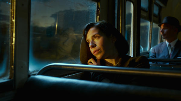 Elisa (Sally Hawkins) prepares to put in a good word for your old buddy Gill, because the wolves are at Old Gill's door, in <em>The Shape of Water</em>.