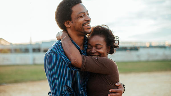 Christopher and Christine'a Rainey embrace in <em>Quest</em>.