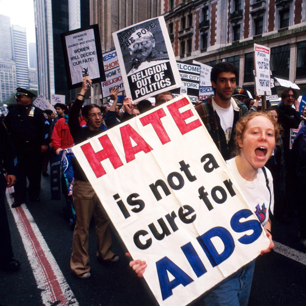 Protestors carry signs at a rally in New York City on October 7, 1995 in New York City. Activists played a key role in speeding research that developed treatments for HIV.