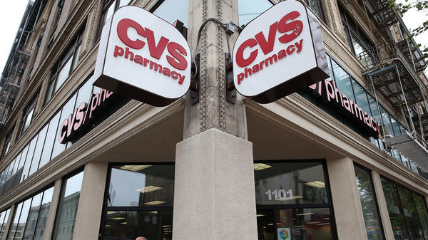 A CVS store is pictured in 2015 in San Francisco. CVS Health is reportedly preparing to purchase Aetna for $69 billion.