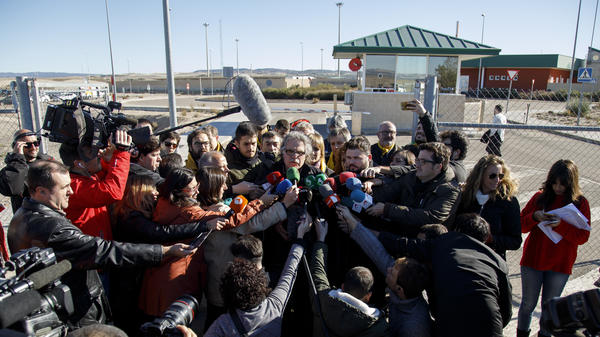 Catalan members of the Spanish parliament speak to the press outside Estremera prison, outside of Madrid, on Monday. A judge from Spain's Supreme Court granted bail to six imprisoned former members of the Catalan government, while two other politicians and two activists will remain in jail.