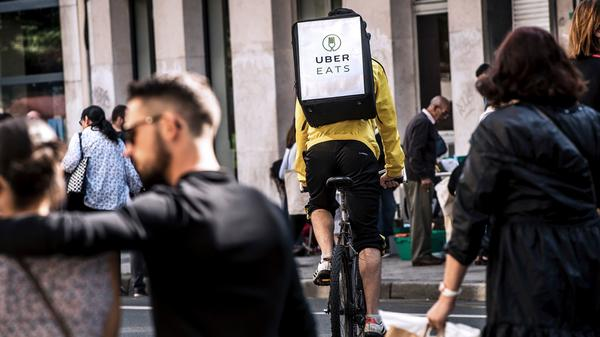 A cycle courier for meal delivery service Uber Eats rides past in Lille, France, on Sept. 2, 2017. In the U.S., advocates are raising concerns about the safety of workers in the gig economy.