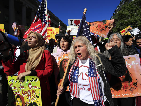 Muslim and civil rights groups and their supporters in Washington, D.C., protest the Trump administration's travel ban in October. The Supreme Court said Monday the ban can be fully enforced for now.