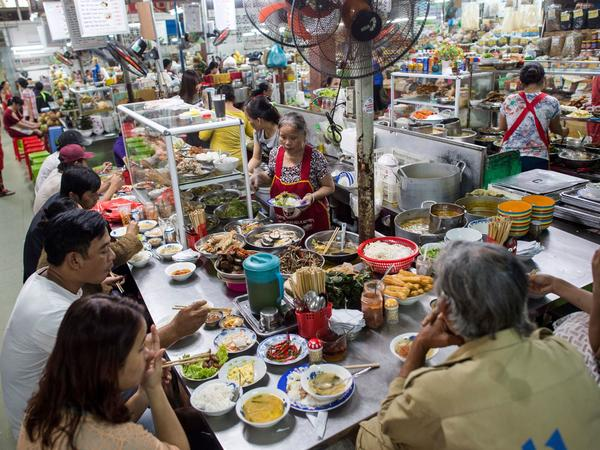 People eat at a noodle stall at the Han Market in the central Vietnamese city of Danang in November. Vietnamese respondents to the Pew Research Center survey overwhelmingly said life is better than it was 50 years ago.