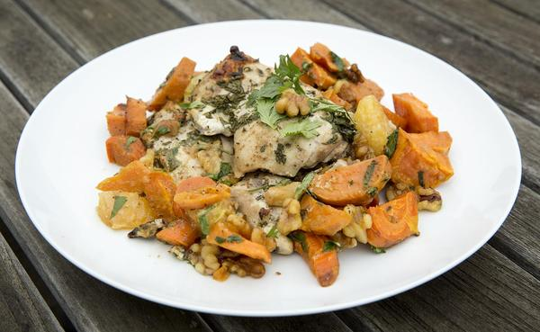 Roast chicken with sweet potatoes, carrots, tangerines and walnuts. (Robin Lubbock/WBUR)
