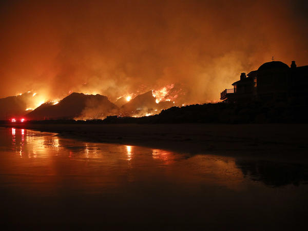 A wildfire burns along the 101 Freeway on Tuesday, in Ventura, Calif.