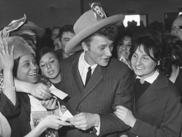 Johnny Hallyday was surrounded by fans at Orly Airport in Paris, on his return from a tour of the United States in 1962.