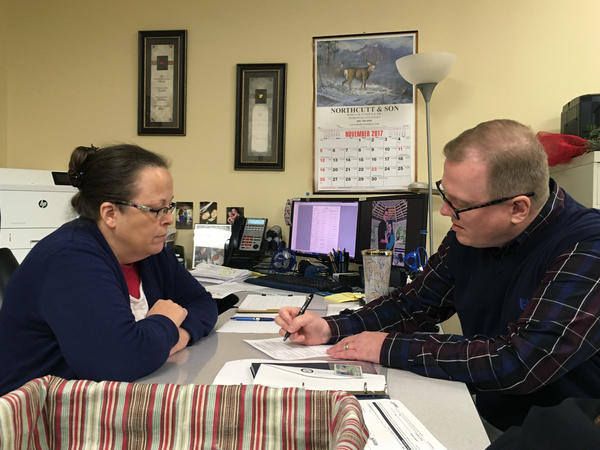 David Ermold files to run for Rowan County Clerk as Kim Davis looks on, two years after Davis denied Ermold and his now-husband a marriage license because she was opposed to same-sex marriage.