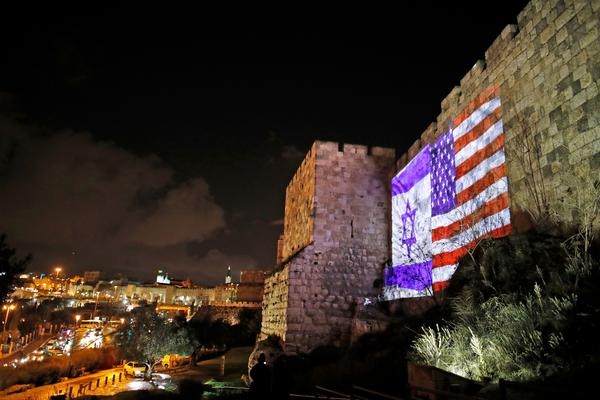 "The American and Israeli flags are on display Wednesday on the walls of the Old City of Jerusalem. President Trump announced that the U.S. will view Jerusalem as the capital of Israel, and he ordered the State Department to ""begin preparation to move the American Embassy from Tel Aviv."" The controversial move threatens to unsettle the region's volatile politics."