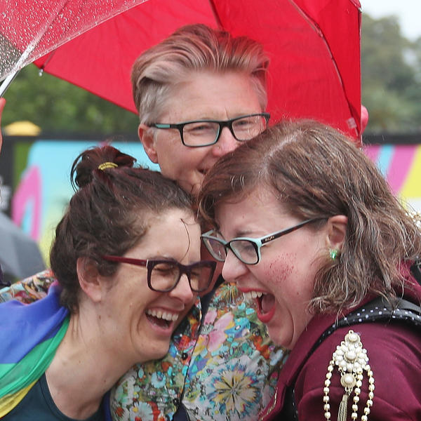 A group of women in Federation Square in Melbourne react on Thursday as it is announced that same-sex marriage will be legal in Australia.