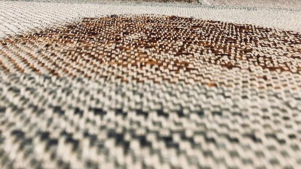 Closeup of Christy Matson's artwork. She uses Japanese paper yarn that she handpaints.