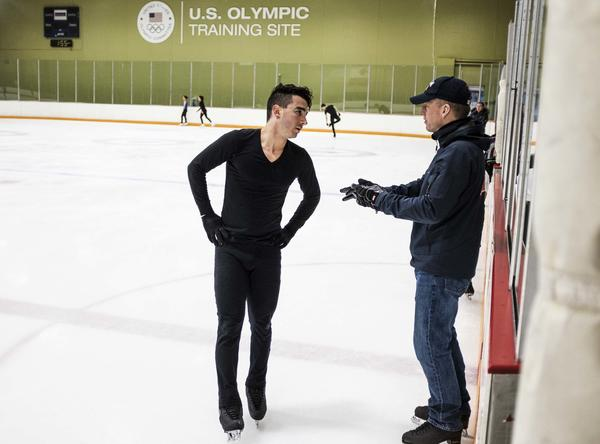 Max Aaron talks with his coach, Tom Zakrajsek, during practice at the World Arena Ice Hall in Colorado Springs.