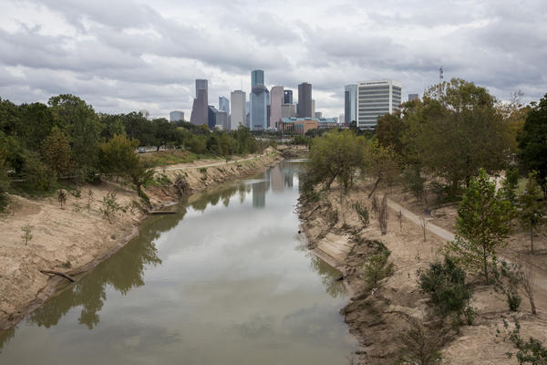 A view of Buffalo Bayou and downtown Houston. The dirt along the banks shows the extent of the flooding during Hurricane Harvey.
